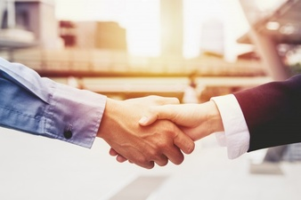 successful-business-people-handshaking-closing-a-deal-business-team-partnership-concept_1962-24